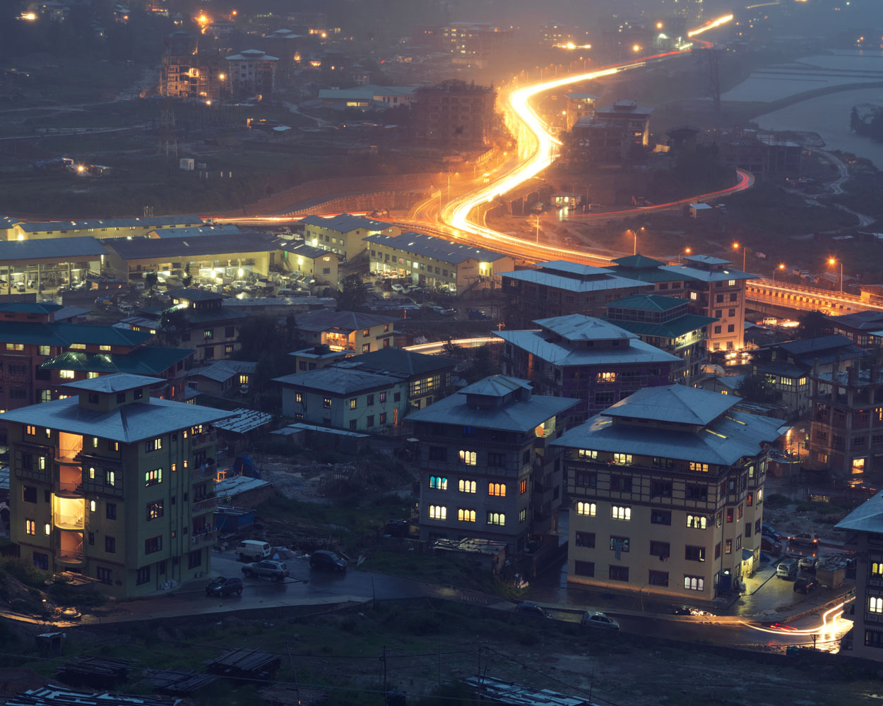New buildings in the district along the Babesa express highway seen from Simtokha road, Thimphu.