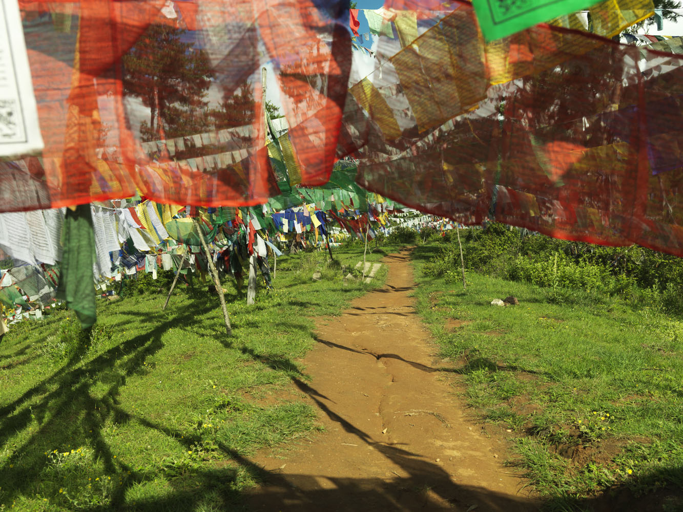 Buddhist Prayer flags around the Bhutan Broadcasting Service tower in Thimpu. BBS is the national radio and television service.