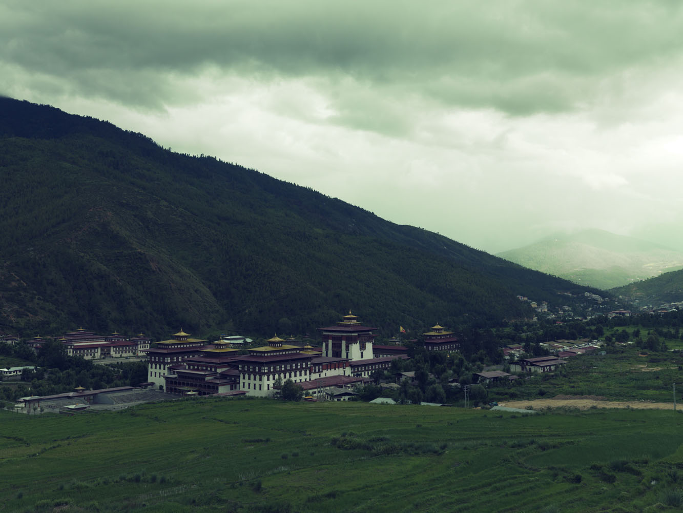 Tashichho Dzong is a Buddhist monastery and fortress on the northern edge of the city of Thimpu. The Dzong is the seat of government and the headquarters of the clergy in the capital.