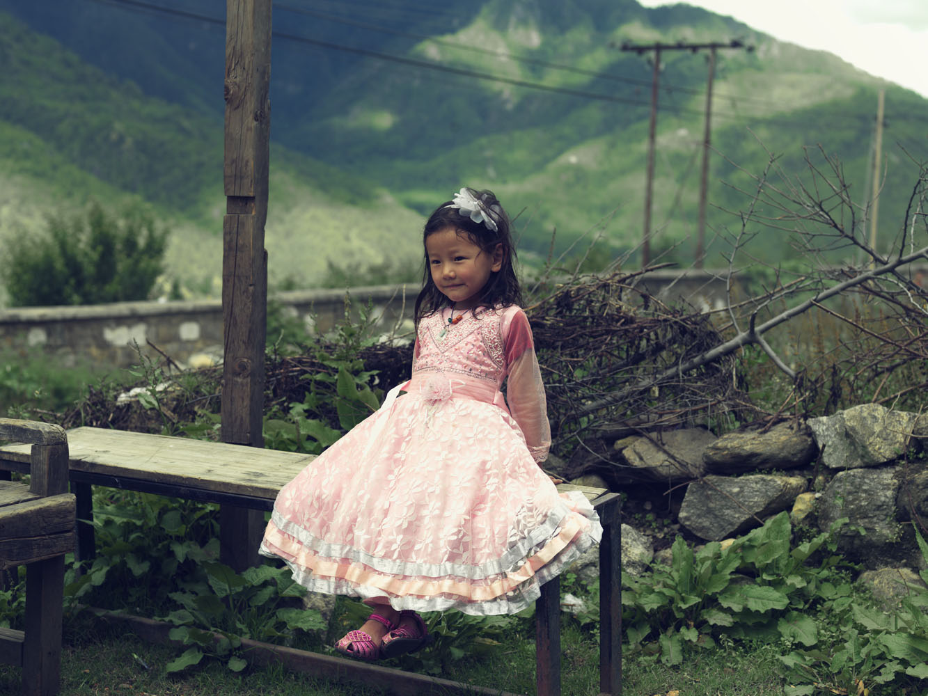 A Bhutanese girl dressed up for a fancy dress party plays outside her house in Paro.