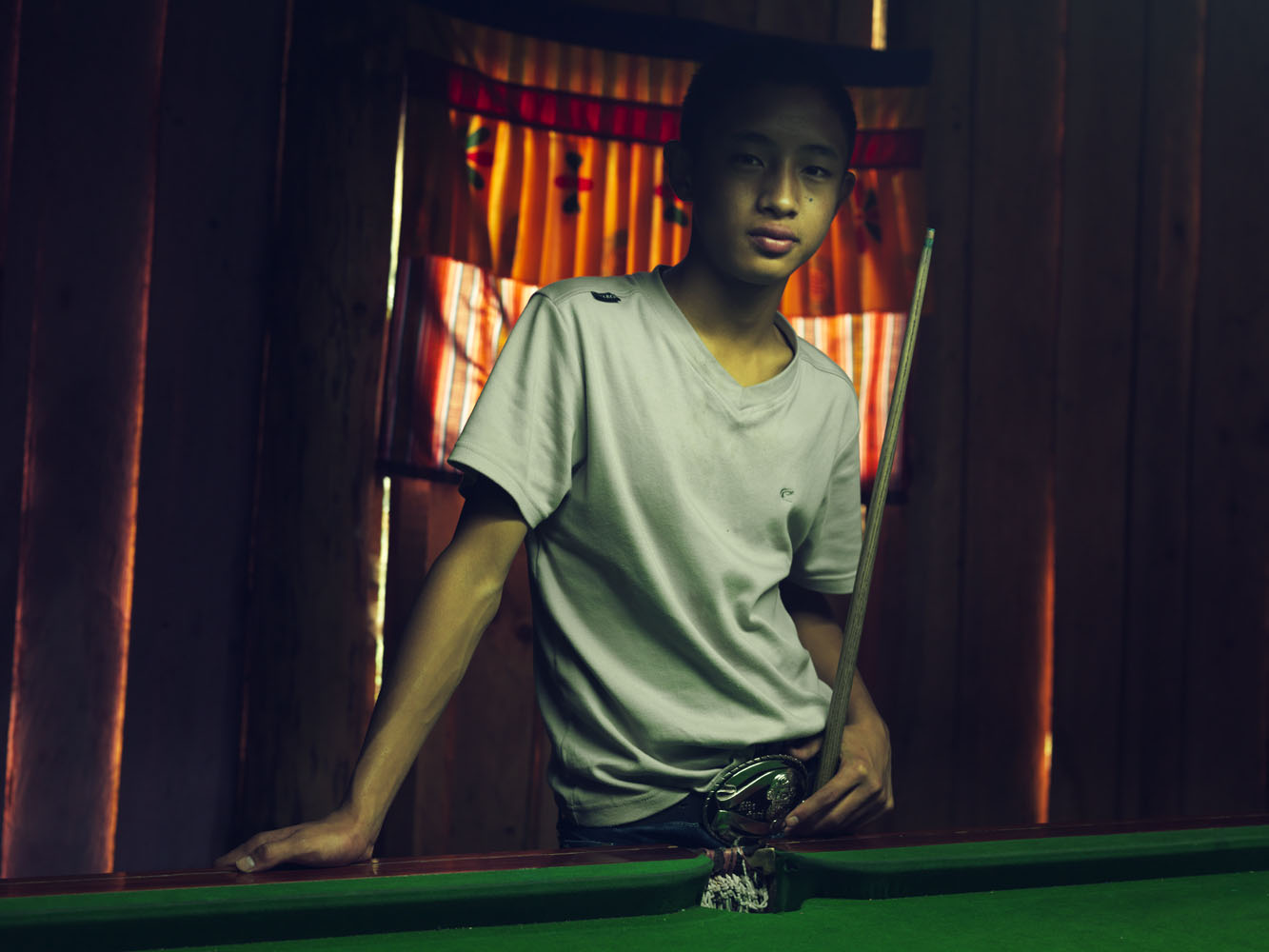 Young boys spend their time playing pool and snooker around the outskirts of Paro.