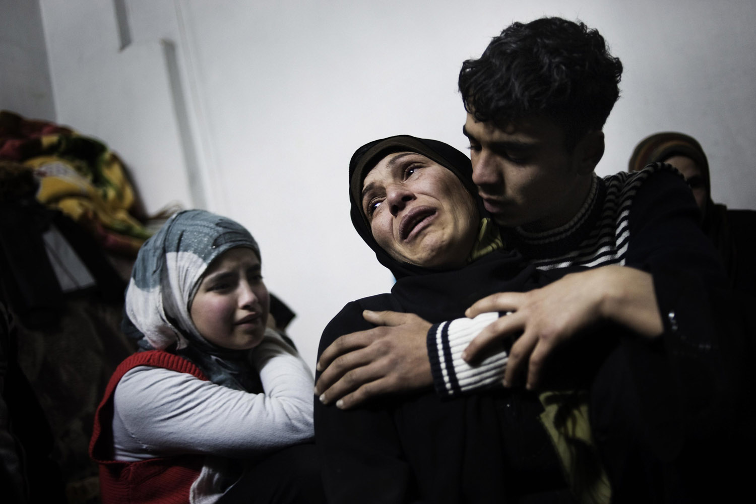 Alessio Romenzi                                                              A mother and her children cry over the loss of two of her sons, who were killed in a mortar attack launched by Assad forces in Homs province.                                                                So far, most of the killing in Syria — maybe 90% — has been innocent civilians. This is an example of that. When you realize that people like this are dying, sure that they're not guilty of anything, you realize how bad it can be. It was just a family sitting in their house. I think that, so far, journalists are the only chance that Syria has. We just try to make as much noise as possible.