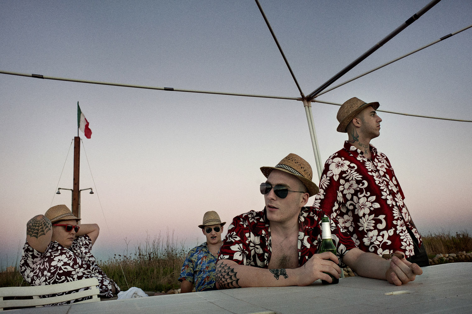 """Young members of the """"Skins 4 Skins"""" group at a Hawaiian party on the Roman seaside, August 2010."""