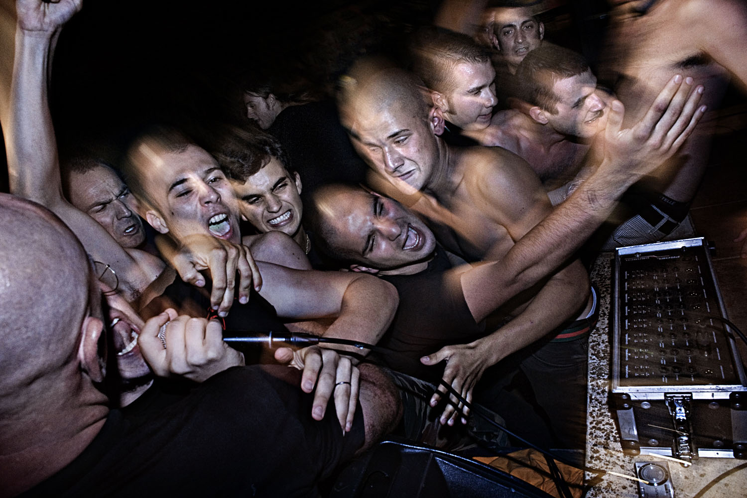 Dancing and fighting during a Nazi-rock concert in Naples, July 2009