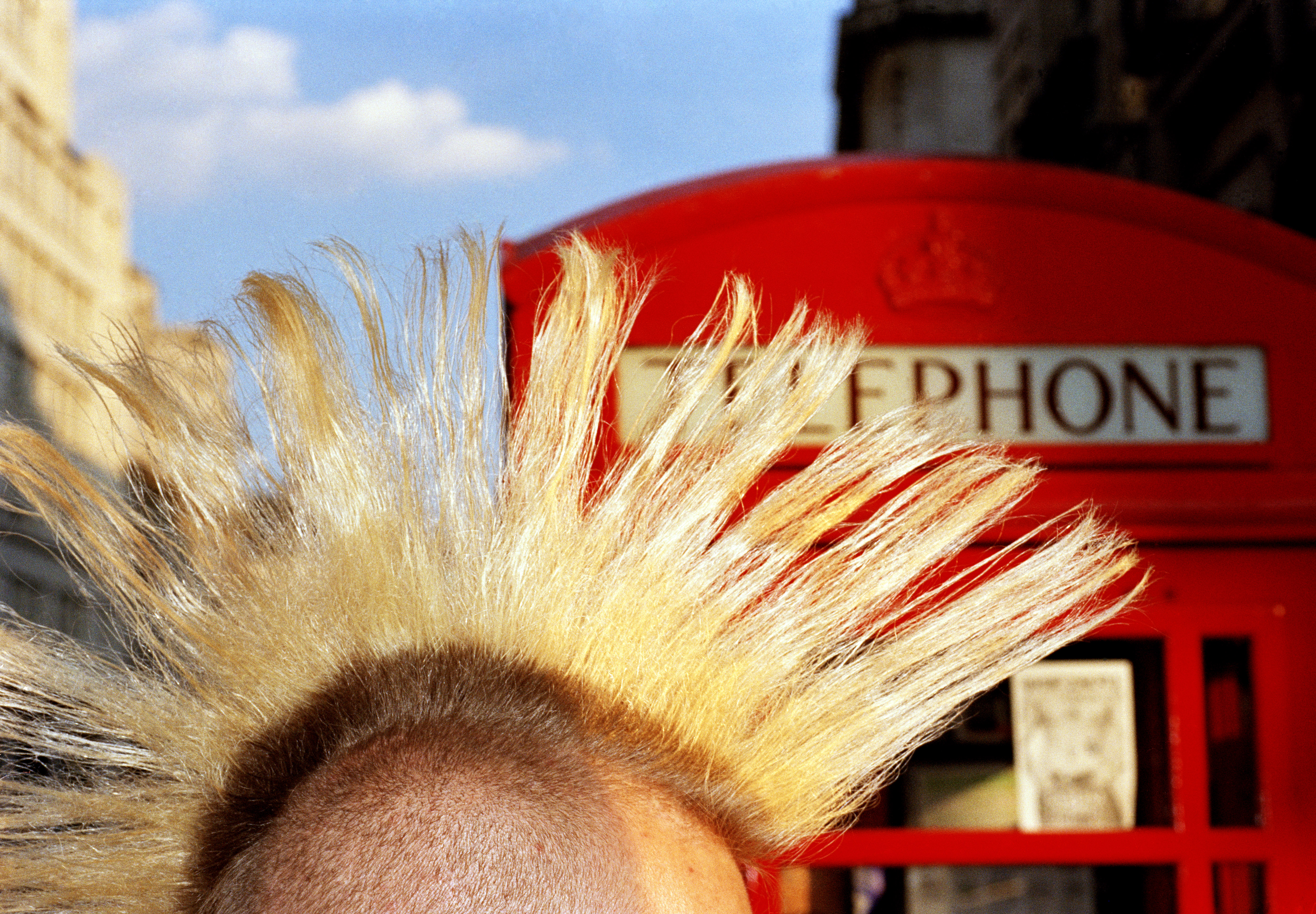 1997. Some punks kept their Mohican haircuts and lived by charging tourists money to photograph them (often by a red bus or telephone box).