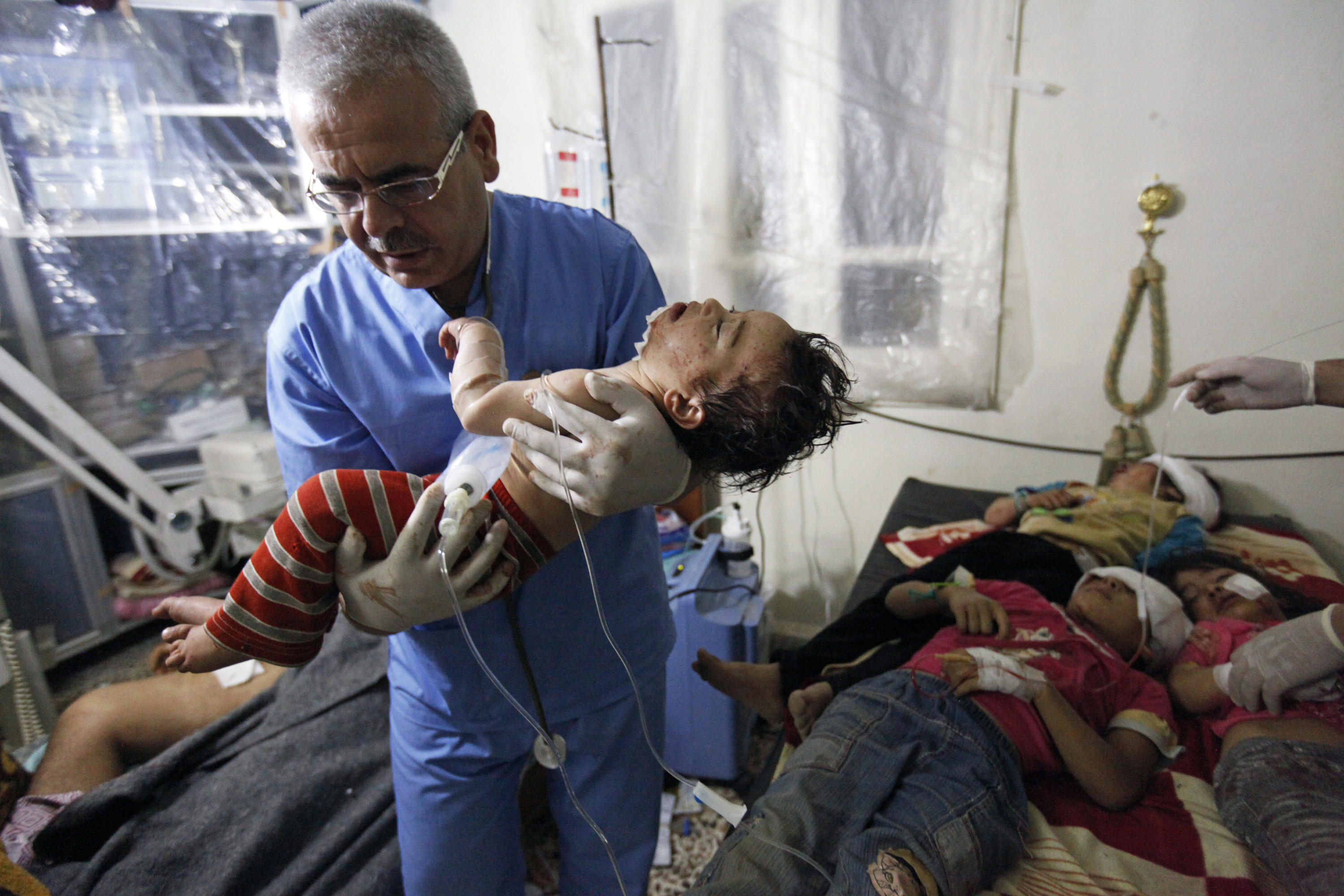 Robert King                                This image acts as a reminder of courage and strength, illustrated in the actions of the doctor. Dr. Kasem is a gastroenterologist who is labeled a terrorist by Assad's regime for honoring one of history's oldest binding documents, the Hippocratic oath, while treating six children wounded by heavy artillery and tank fire.