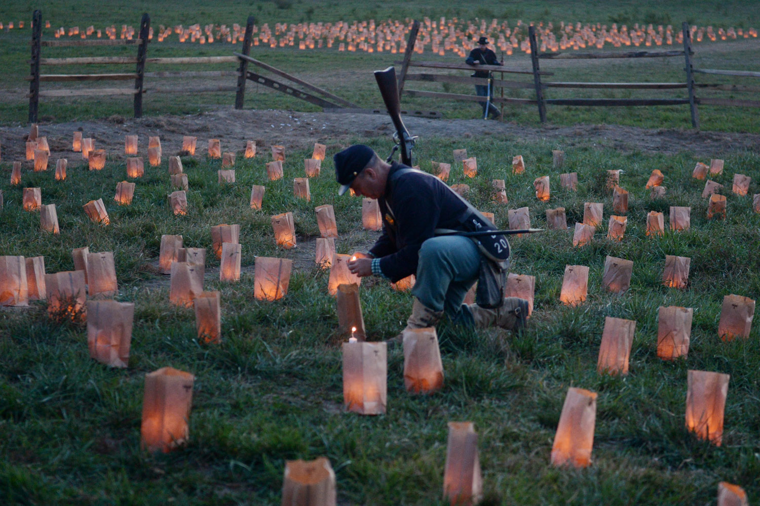Sept. 15, 2012. A reenactor portraying a Union soldier helps to light more then 3,600 candles to commemorate the deaths of Antietam, during the 150th Anniversary Reenactment of the Civil War battle, at Legacy Manor Farm in Boonsboro, Md.