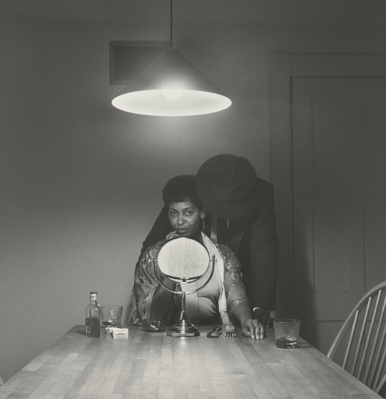 Untitled (Man and mirror)                     from Kitchen Table Series, 1990.