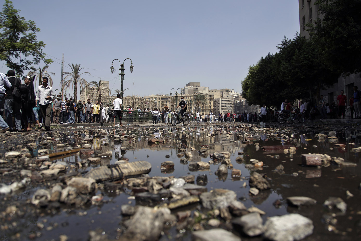 Sept. 14, 2012. Egyptian protesters clash with security forces, not shown, near the U.S. embassy in Cairo. The protests are part of widespread anger across the Muslim world about a film ridiculing Islam's Prophet Mohammed.