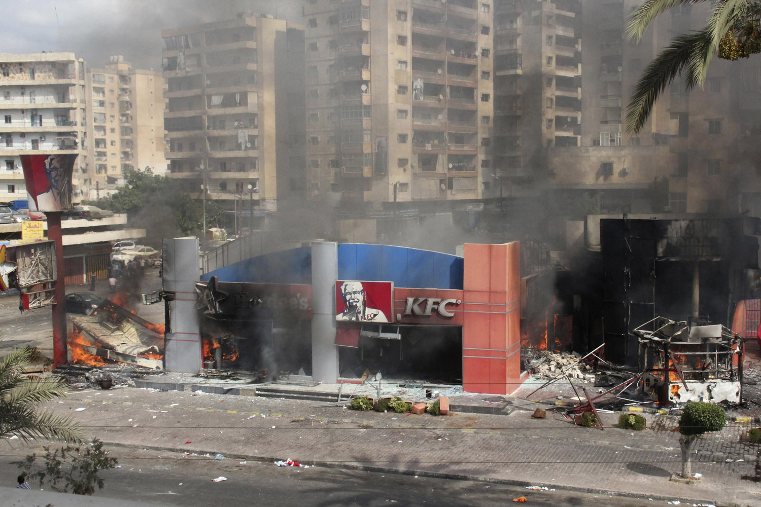 Sept. 14, 2012. Hardee's and Kentucky Fried Chicken restaurants are seen on fire after protesters destroyed and burnt them in Tripoli, northern Lebanon.