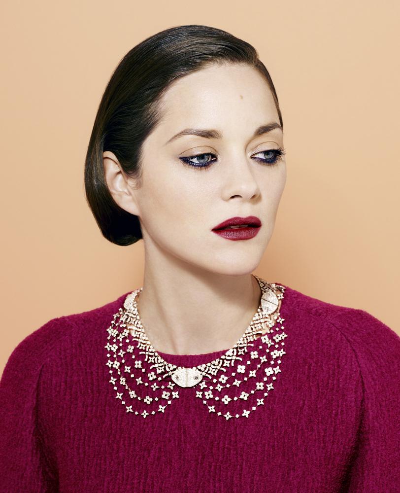 Cotillard wears Dries Van Noten top and Louis Vuitton diamond necklace.