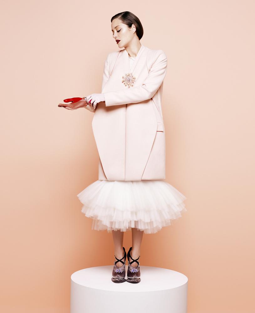 Cotillard wears Antonio Berardi coat, Chanel brooch, Marchesa dress, LaCrasia gloves and Prada shoes.