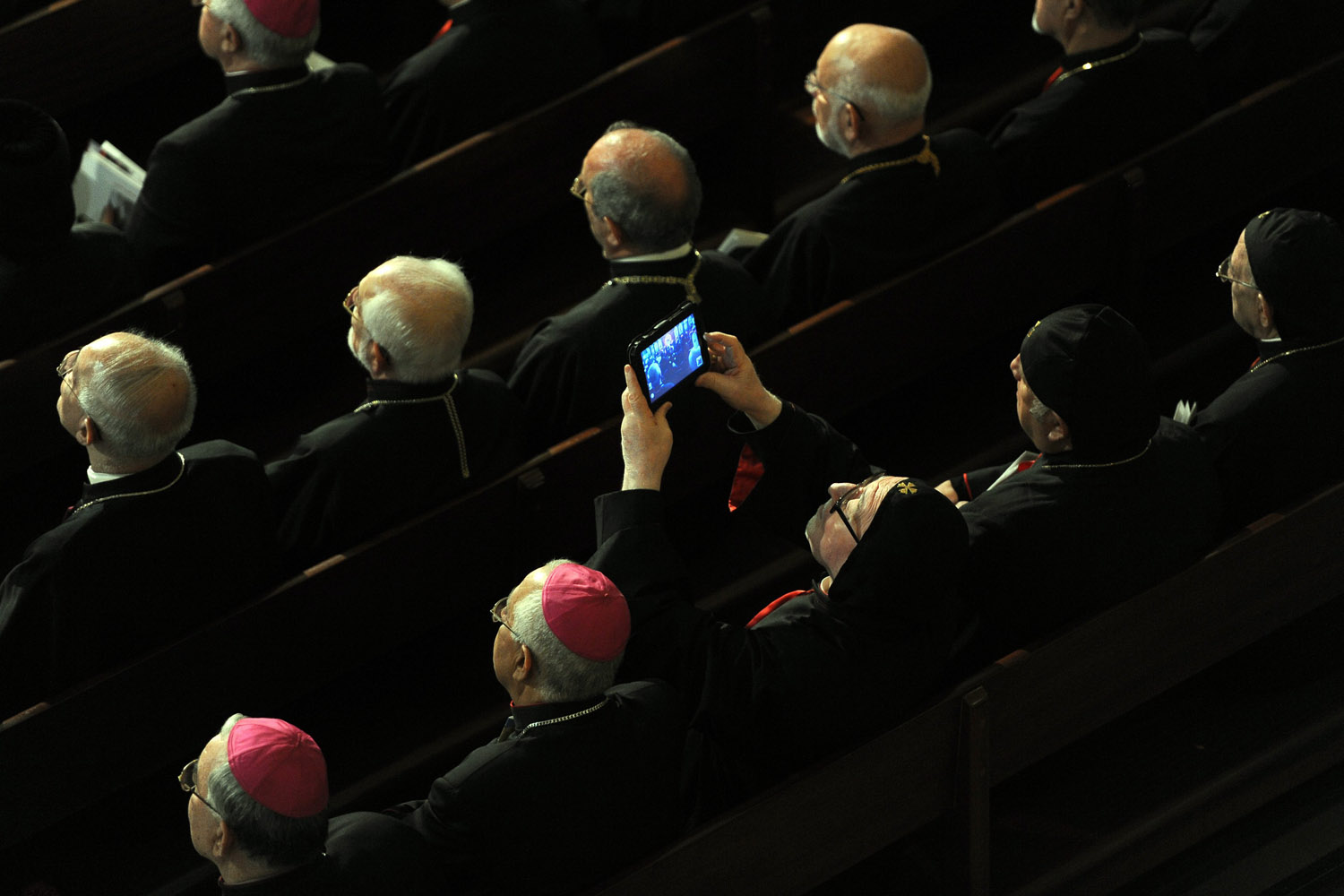 Sept. 14, 2012. A Bishop takes pictures as Pope Benedict XVI (not pictured) leads a ceremony at the Saint Paul cathedral in Harissa village, east Beirut, Lebanon.