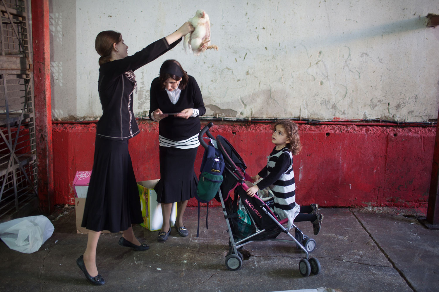 Sep. 20, 2012. An ultra-Orthodox Jewish woman swings a chicken over her family during a Kaparot ceremony in Bnei Brak, Israel. The Jewish ritual is supposed to transfer the sins of the past year to the chicken, and is performed before the Day of Atonement, or Yom Kippur, the most important day in the Jewish calendar, which this year will start on sunset on Sept. 25.