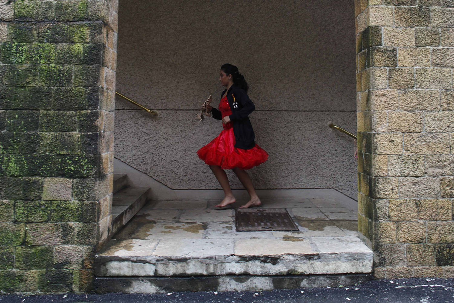 Sept. 15, 2012. A contestant runs with her shoes in her hand during the 4th annual Maharashtra State Open Dance Sport Championship in Mumbai.