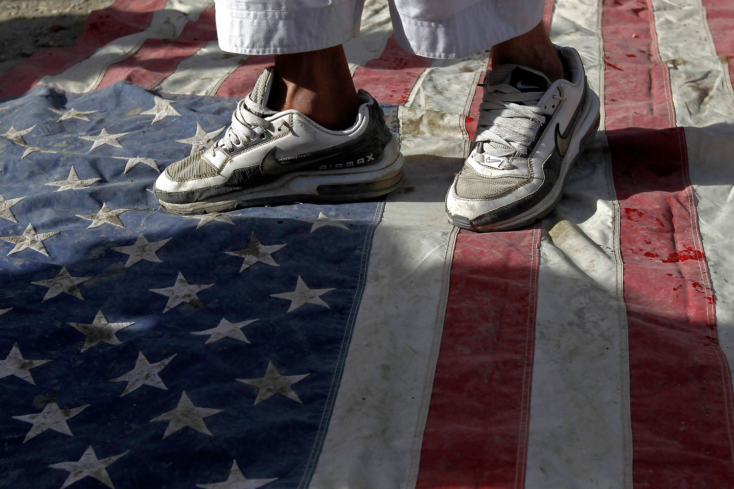 Sept. 21, 2012. An Afghan protester steps on a U.S. flag during a demonstration in Kabul. Hundreds of Afghans protested against a U.S.-made film they say insults the Prophet Mohammed.