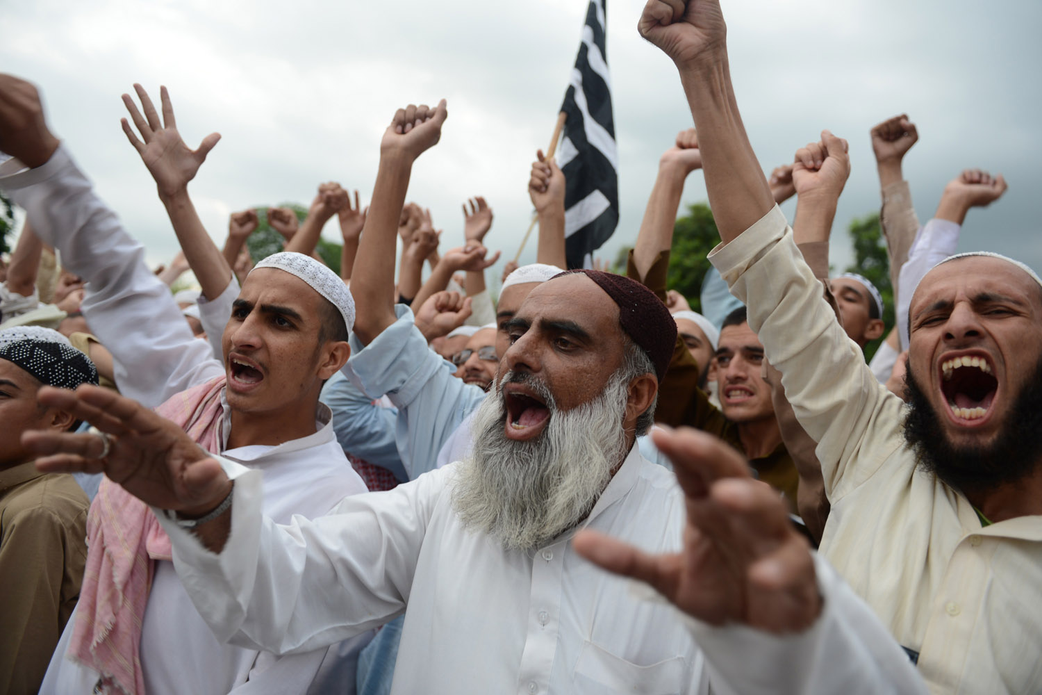 Sept. 16, 2012. Pakistani activists of Jamiat Ulma e Islam shout slogans during a rally against an anti-Islam movie in Islamabad.