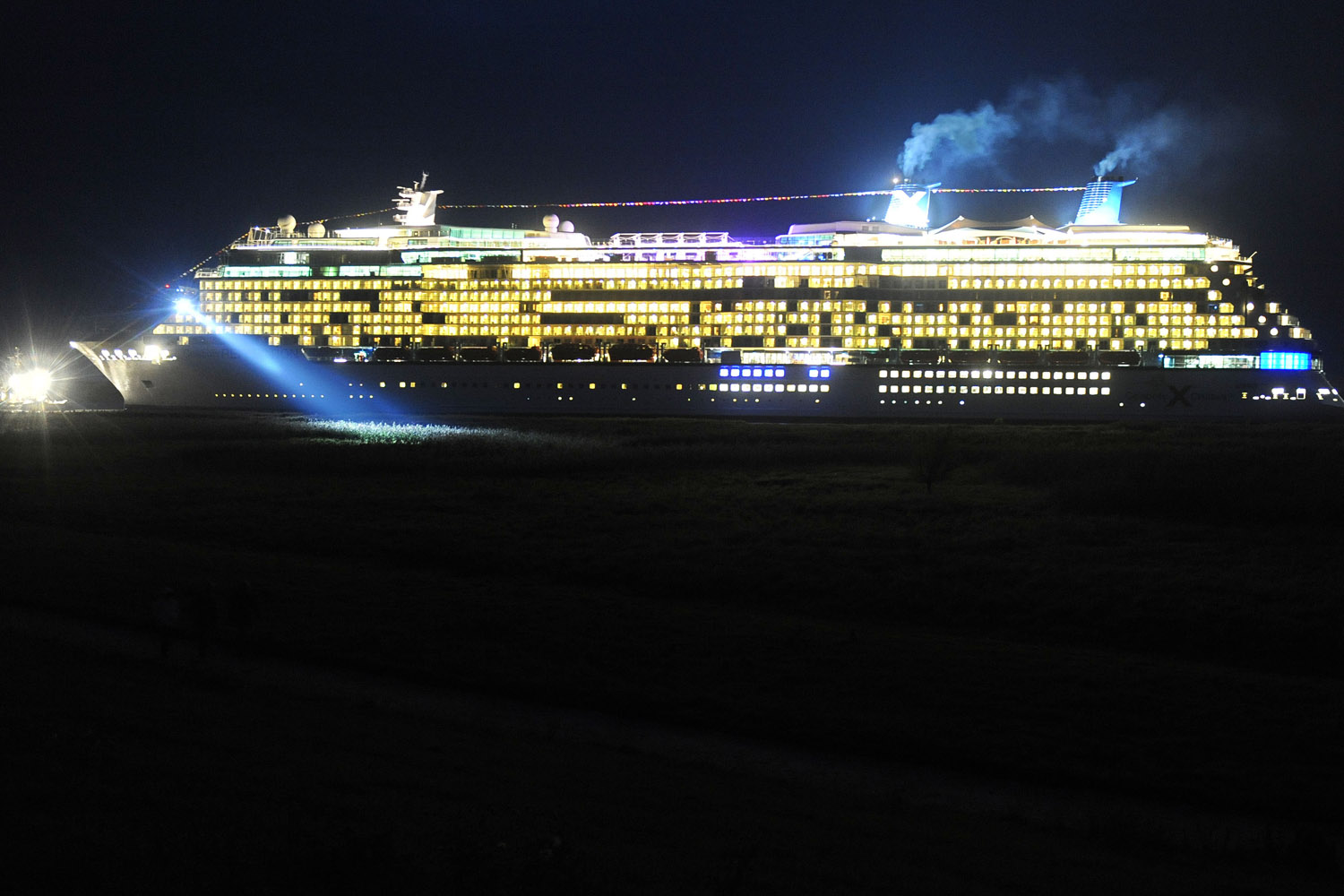 Sept. 16, 2012. The new cruise ship 'Celebrity Reflection' is transferred from the fitting pier of the Meyer shipyard in Papenburg, Germany via the Ems River to the North Sea.