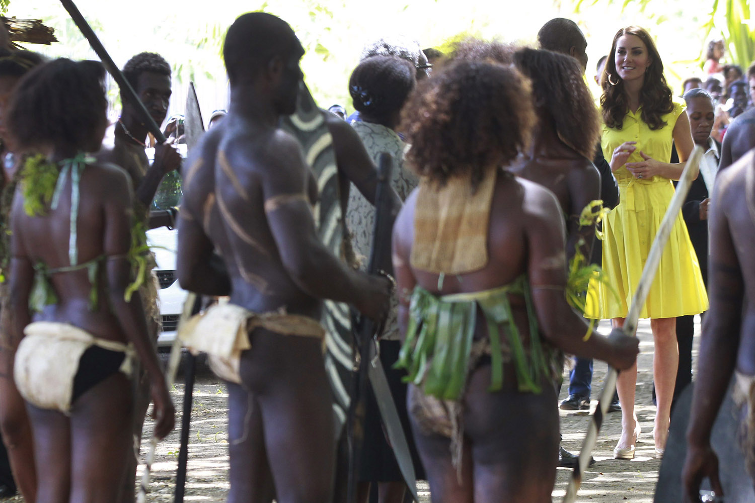 Sept. 17, 2012. Britain's Catherine, the Duchess of Cambridge, talks to traditional dancers at a cultural village in Honiara, Solomon Islands.