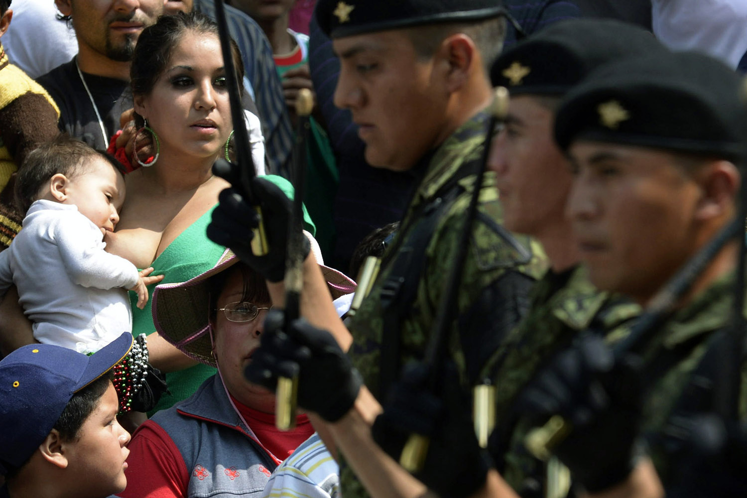 Sept.16, 2012. A woman breastfeeds her child while attending a parade during the celebration of the 202nd anniversary of Mexico's independence at Juarez Avenue in Mexico City.
