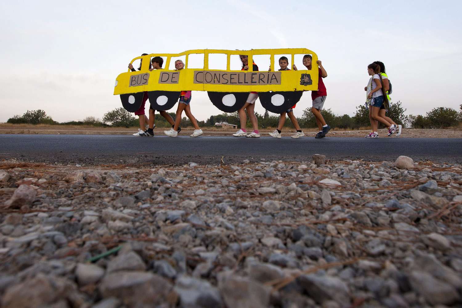 Sept. 17, 2012. Children walk with a cartoon school bus during a protest against the Spanish government's cuts on school transport, in Pobla de Vallbona, eastern Spain.