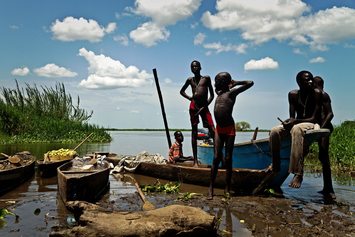 Sept. 17, 2012. Boys from the Mandari tribe wait by the Nile river for boats with the day's catch to arrive in Terekeka, a fishing community 75km north of Juba in South Sudan.