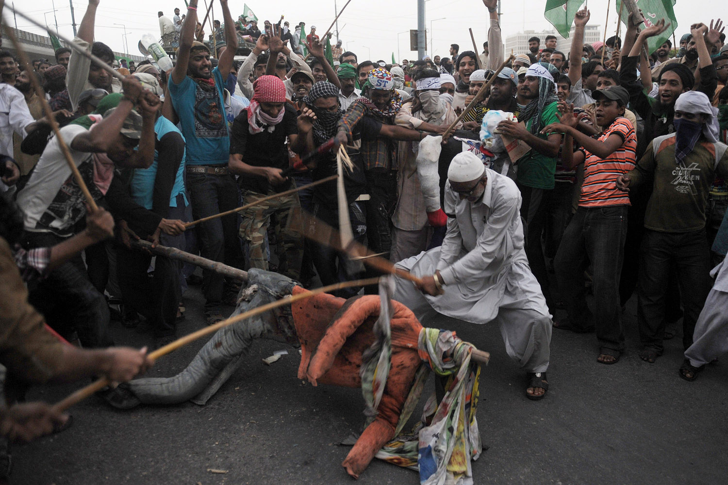 Sept. 18, 2012. Pakistani Sunni Muslims protesters beat an effigy of U.S. President Barack Obama during a protest against an anti-Islam movie in Peshawar, Pakistan.