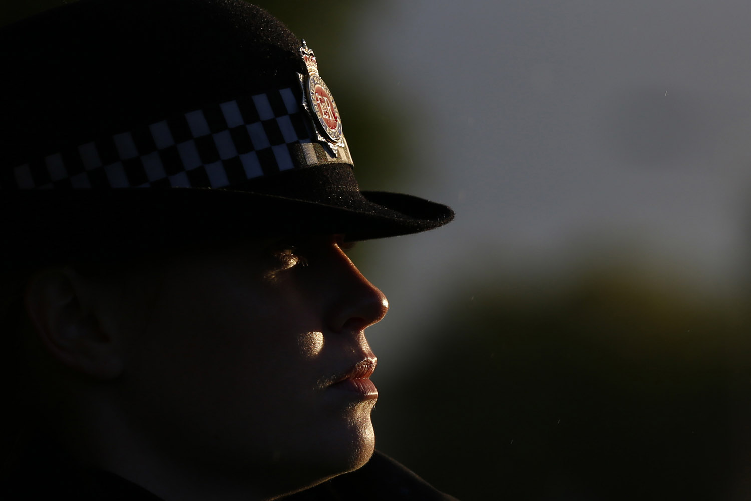 Sept. 18, 2012. A police officer guards the scene where two female police officers were killed in Hattersley near Manchester, northern England.