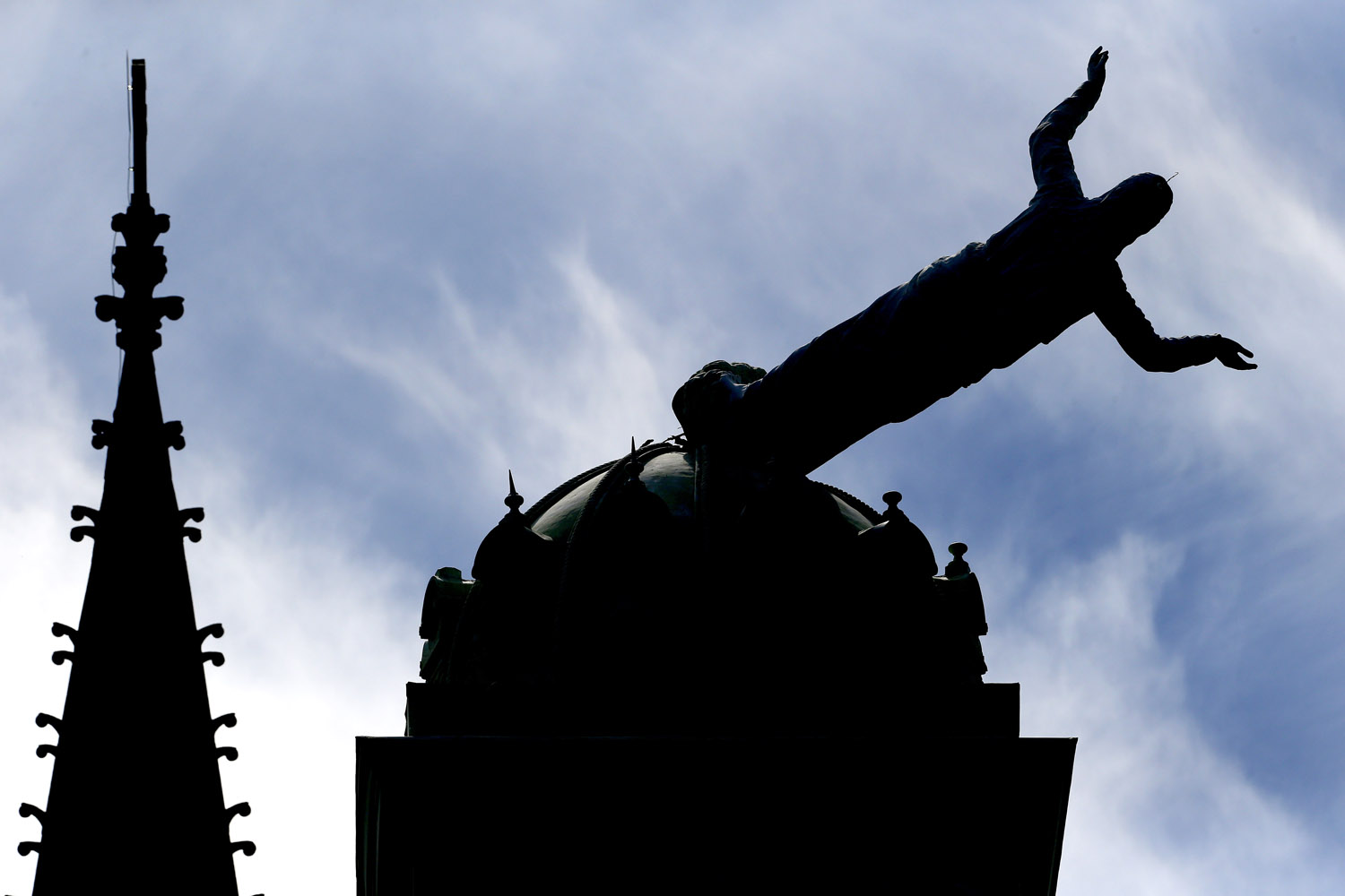 Sept. 19, 2012. A statue of Jesus Christ lays on its side on top of the St. John's School building following high winds in Orange, N.J.