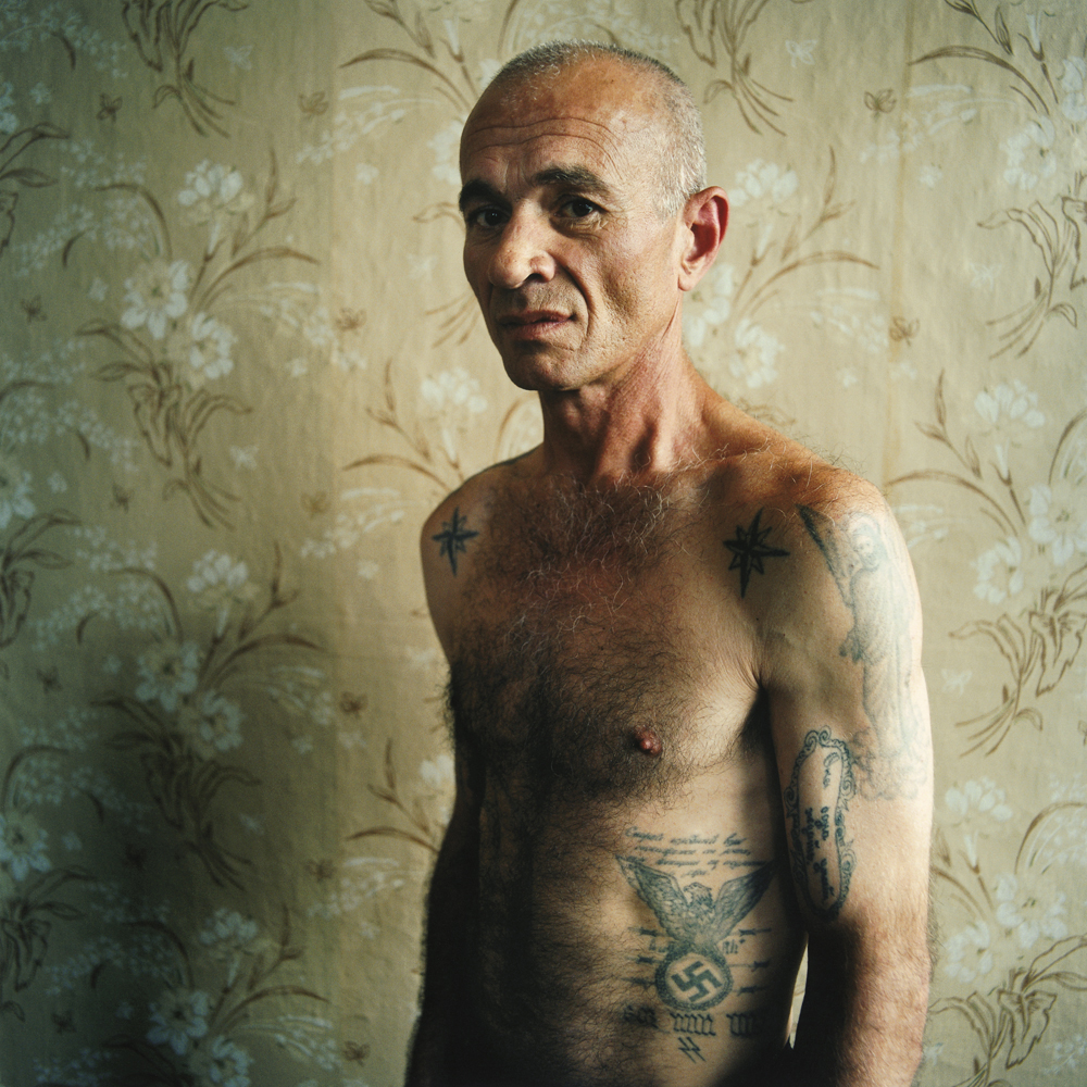 A man with a swastika tattoo(didn't reveal his crime).Men's prison, Ukraine, 2008.