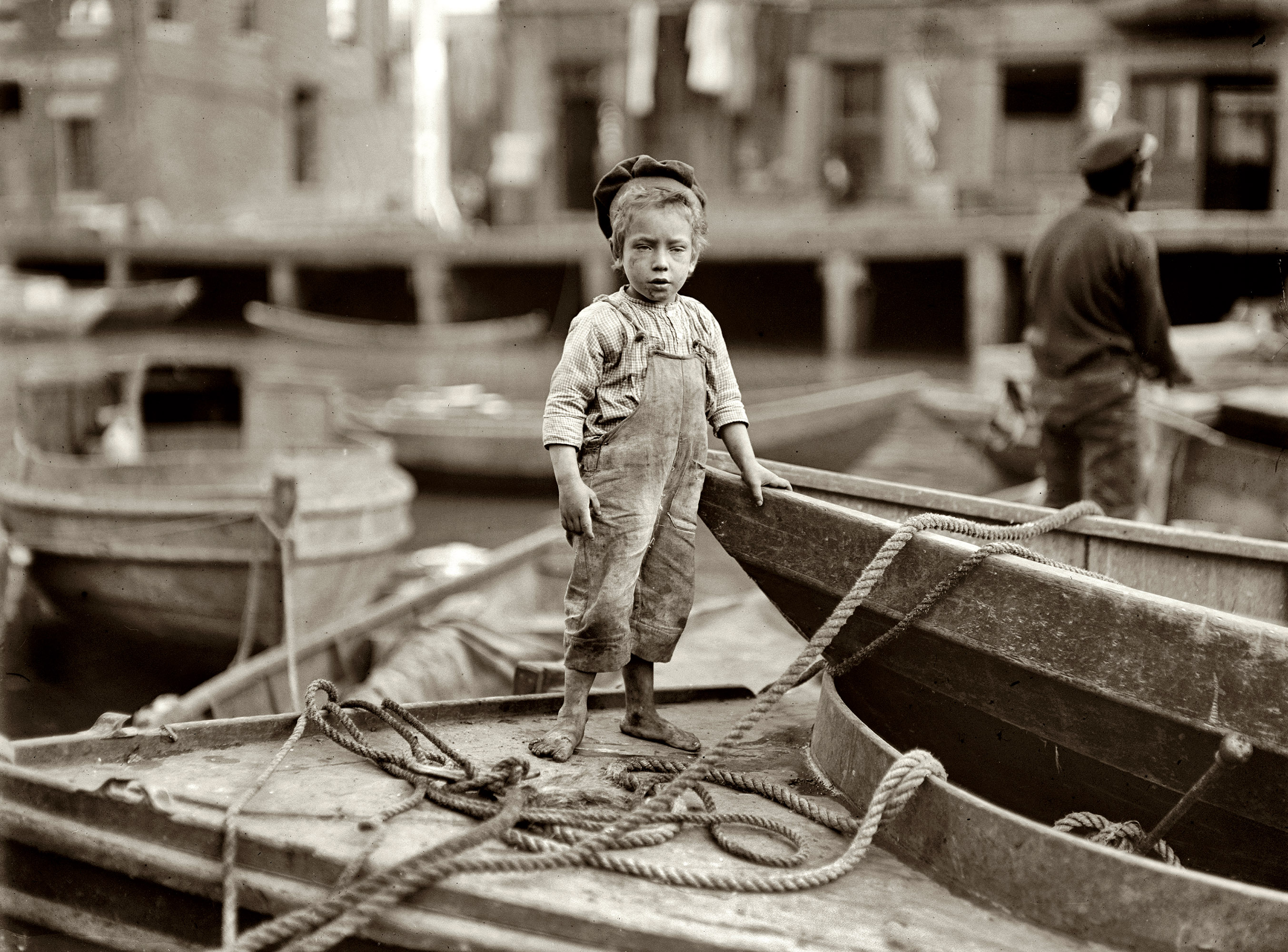 October 1909. Boston.  Truant hanging around boats in the harbor during school hours.