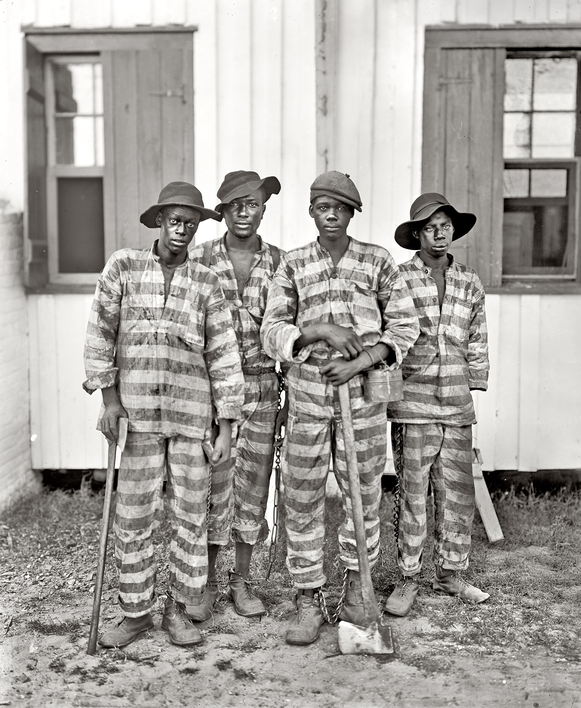 Circa 1905, in the American South.  A Southern chain gang.