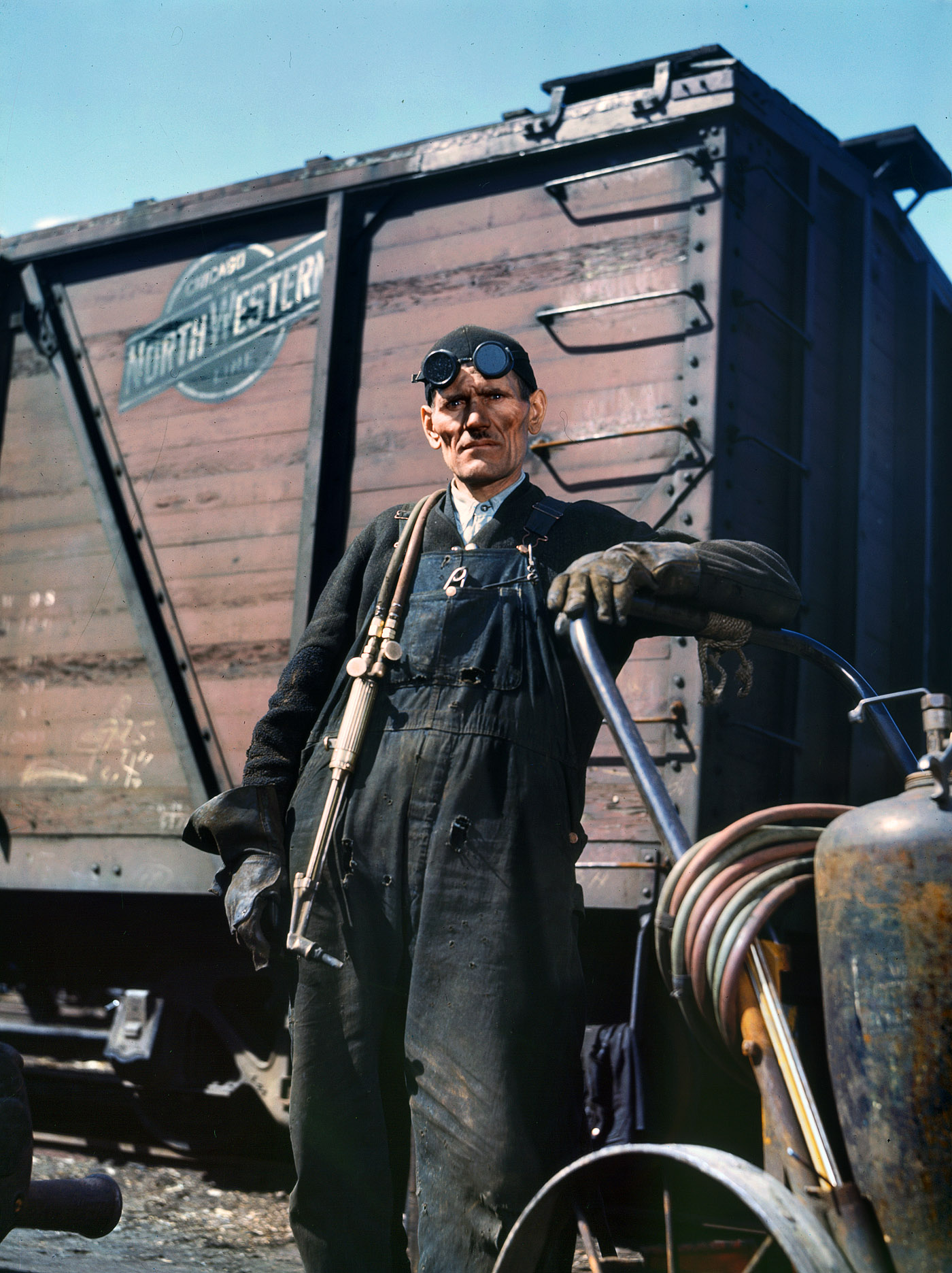 Chicago, April 1943.  Mike Evans, a welder, at the rip tracks of the Proviso Yard, Chicago & North Western R.R.