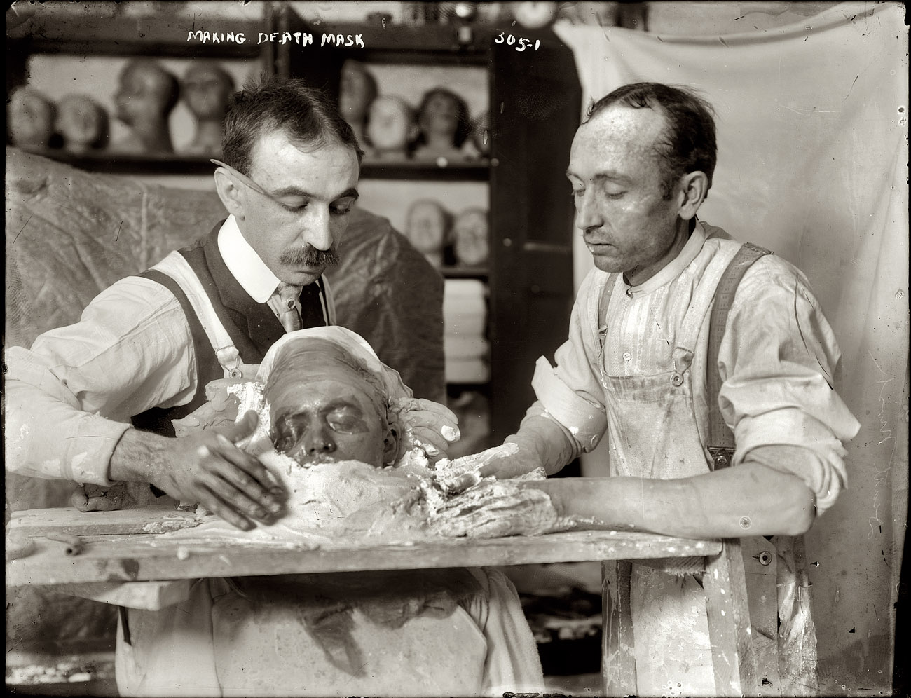 New York circa 1908. Making a plaster death mask.
