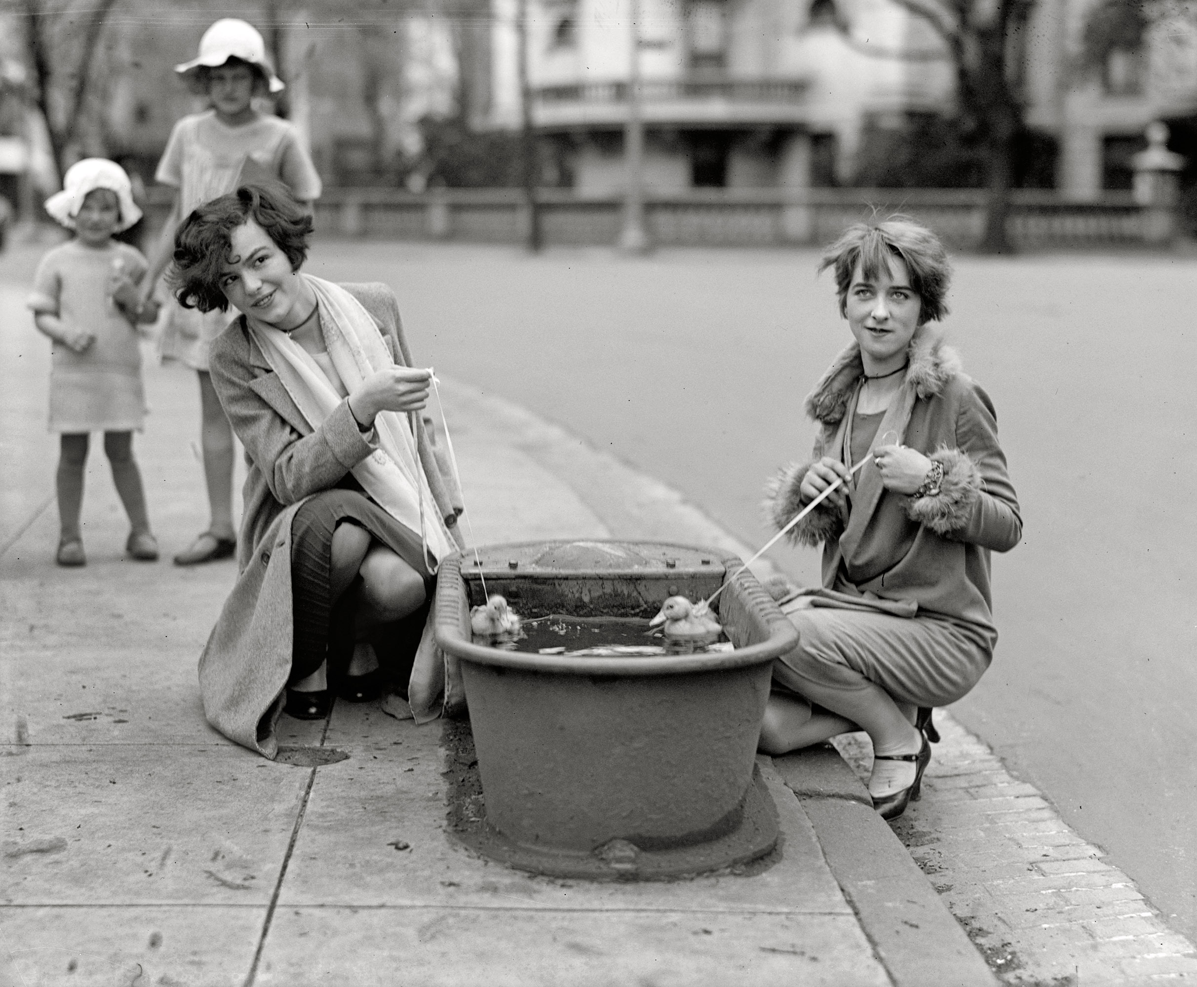 April 21, 1927.  Do ducks swim? Misses Eugenia Dunbar and Mary Moose.  The main focus here is of course the horse trough, once a common item of street furniture in many big cities.