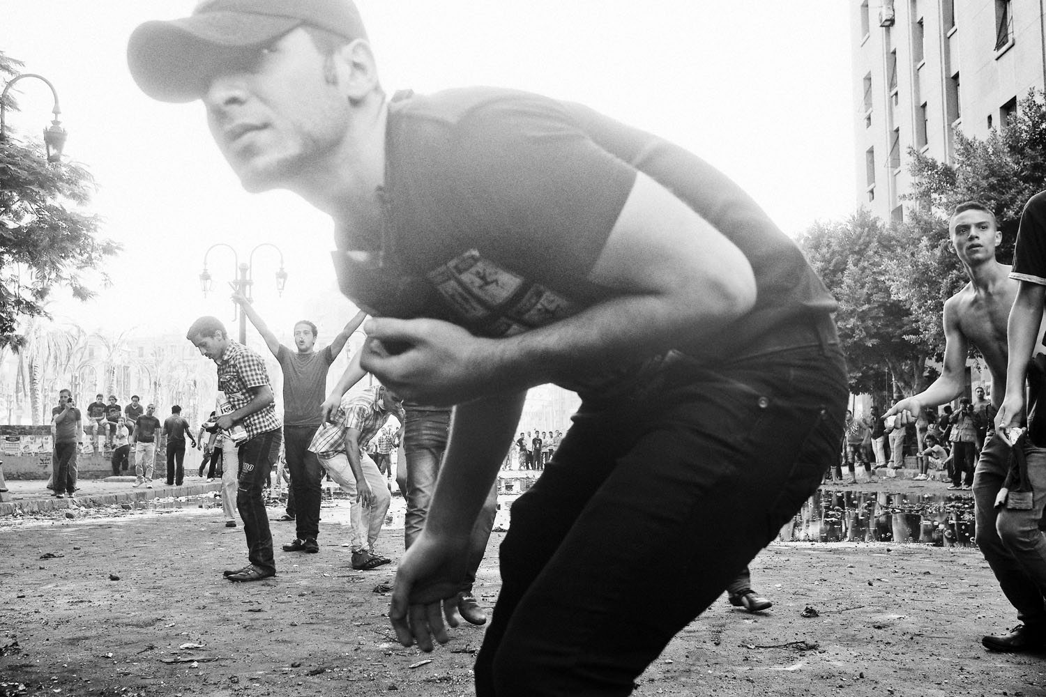 The following photographs were taken on Sept. 13-14, 2012.                               Protestors throw rocks at Egyptian security forces protecting the area near the U.S. Embassy in Cairo.