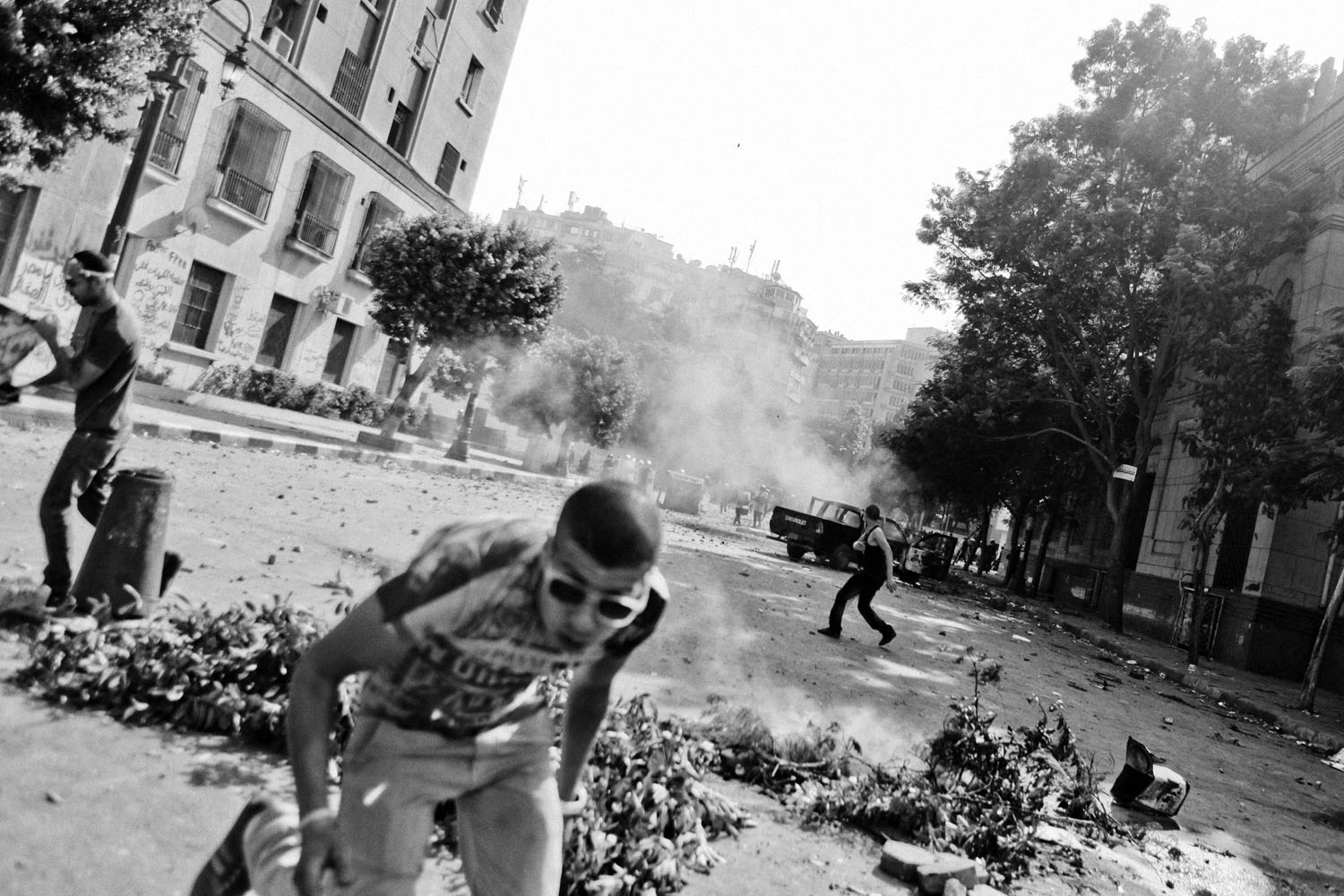 Protestors run during clashes near the U.S. Embassy.