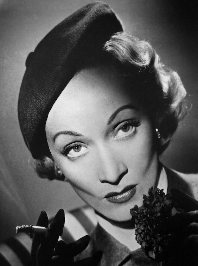 Marlene Dietrich, 1948 I first had the opportunity to photograph Marlene Dietrich whilst working at Denham Studios. I rushed into the studio and was given a set on a small corner of an enormous 120 ft. by 80 ft. stage. I was nervous. Once set up, I waited in the dark, with my radio at the ready thinking it might help ease the situation and, more importantly, calm my nerves. Suddenly a light came on in the entrance to the studio a hundred feet away, and she and her entourage proceeded across the stage.  I only took five photographs of her that day. The shoot finished and she announced she would be back the next day to see the rough prints. I re-touched the prints following her explicit and detailed instructions to a tee. The next day Dietrich arrived, took out her magnifying glass again and re-examined the prints. Pleased, she turned to me, shook my hand and said, 'Join the club Mr. Lucas.' I was rather perplexed and wasn't sure what she meant so asked her publicist what she had implied. He simply sad 'Mr. Lucas it means, you're on the road to success.' And I was!