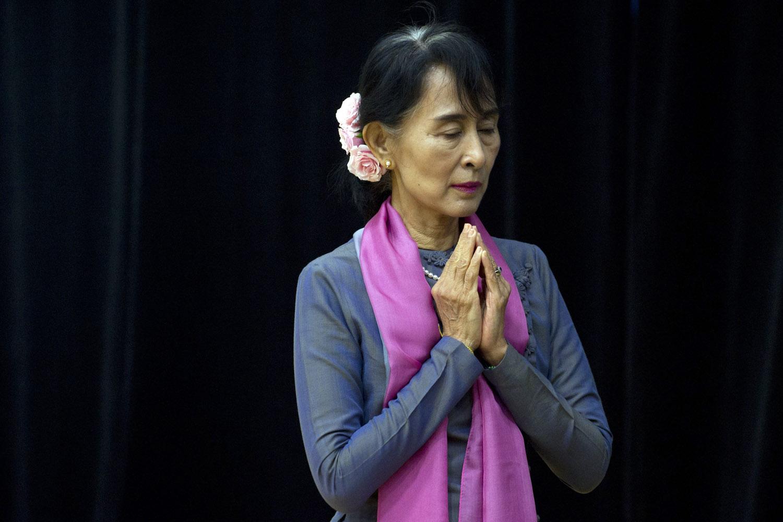 Sept. 20, 2012. Aung San Suu Kyi of Myanmar prays prior to speaking at American University in Washington, D.C.