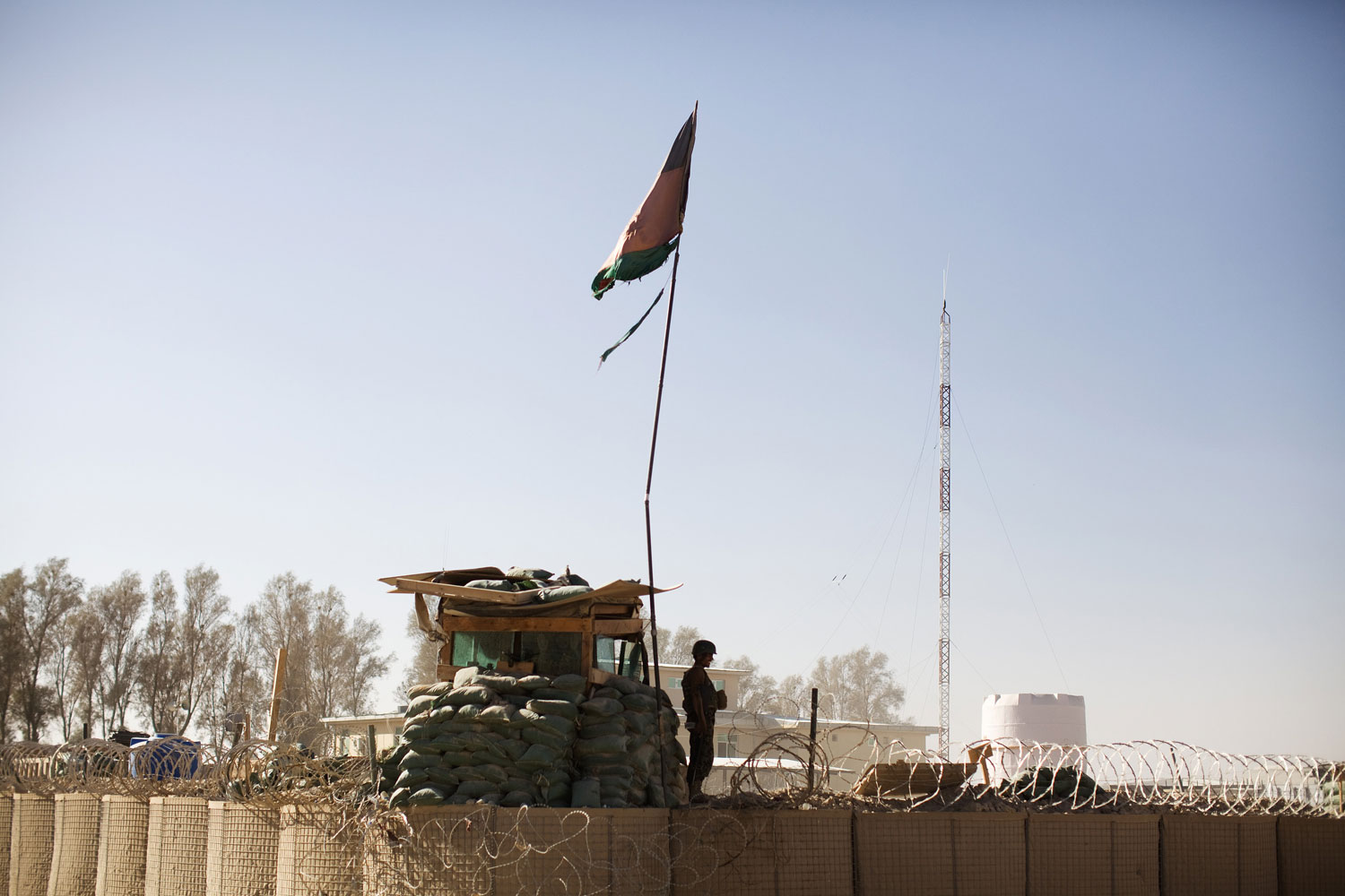 Sept. 18, 2012. An Afghan National Army soldier stands at the gates of a compound in Helmand province, Afghanistan. International forces in Afghanistan were ordered to stop all joint patrols with Afghan security forces due to the increased threat from  insider  attacks.