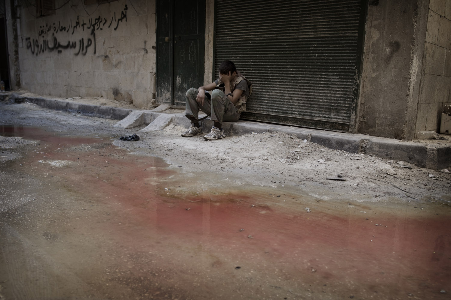 Sept. 2, 2012. A Free Syrian Army fighter rests in exhaustion after heavy fighting in Aleppo, Syria.