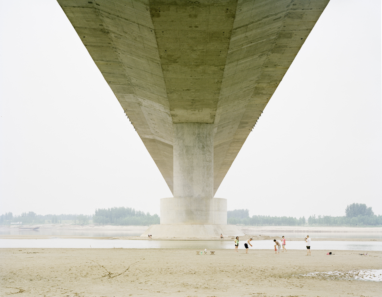 A family having fun under the bridge, Shandong province.