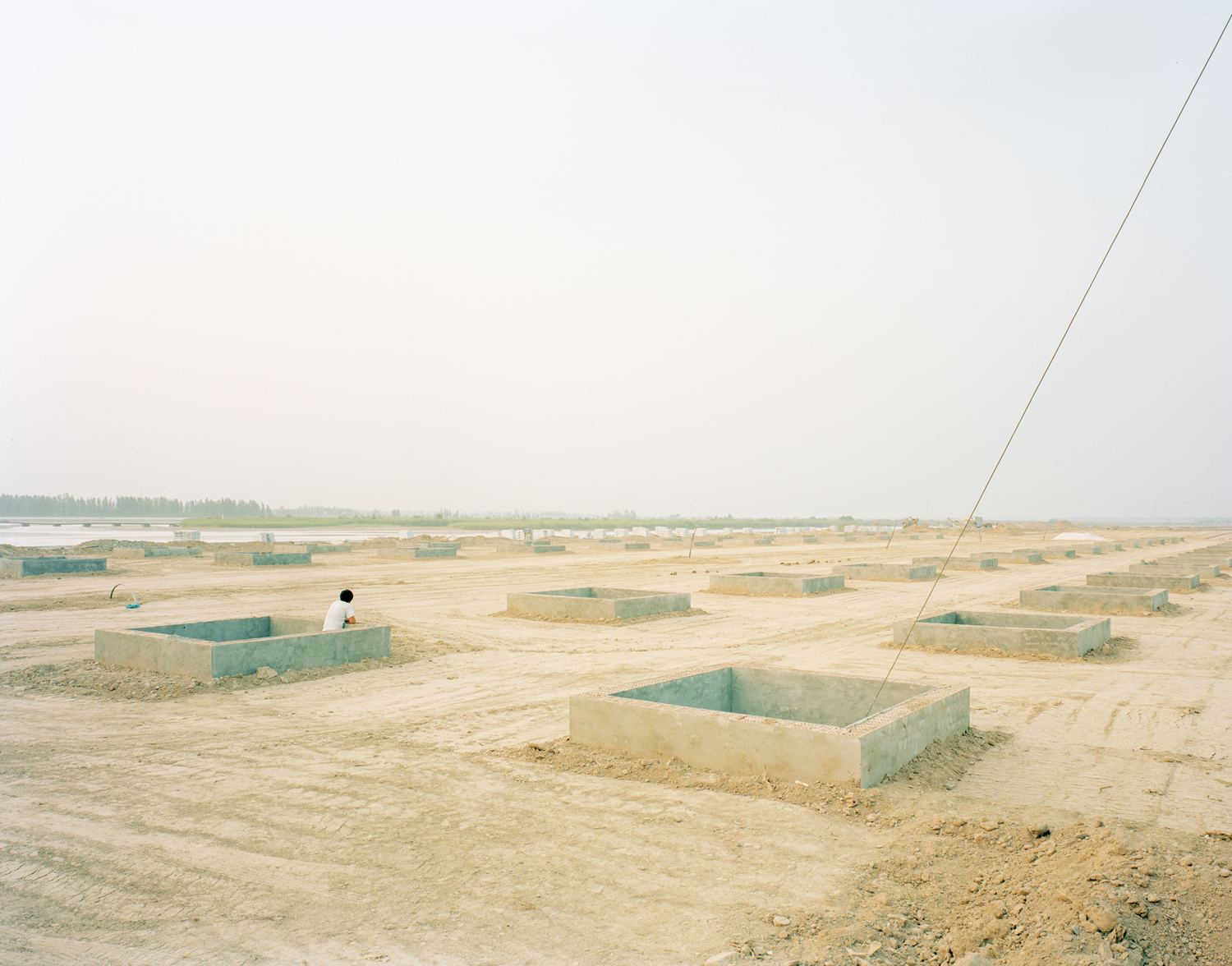 A worker in a construction site of the riverbank, Ningxia province.