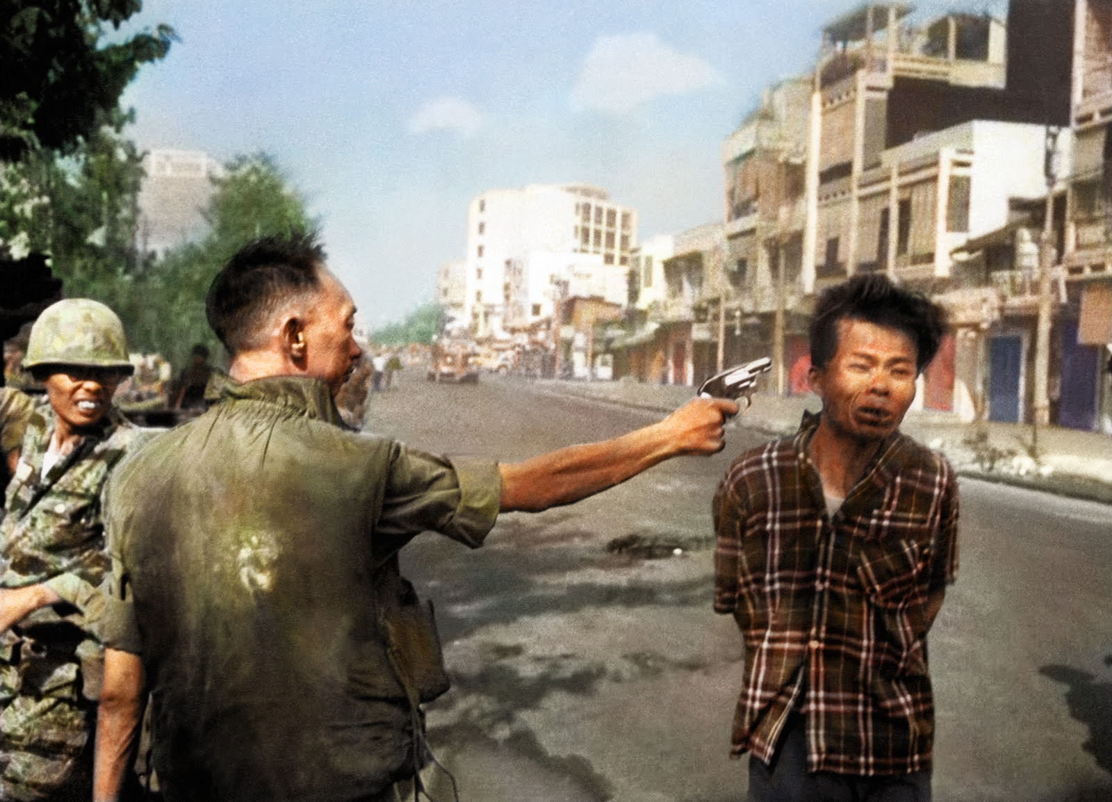 On Feb. 1, 1968, South Vietnamese Gen. Nguyen Ngoc Loan, chief of the national police, fires his pistol into the head of suspected Viet Cong officer Nguyen Van Lem, also known as Bay Lop, on a Saigon street, early in the Tet Offensive.
