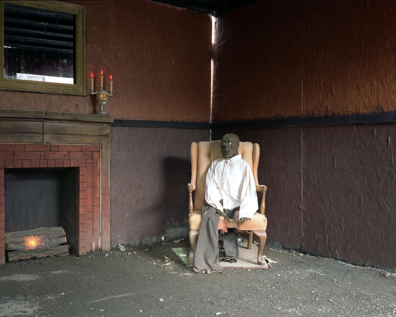 Ghoul in chair                               Haunted Graveyard, Bristol, Conn., 2004