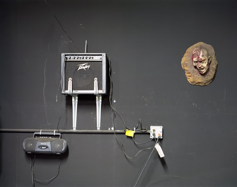 Head with amp on wall                               Spook-A-Rama, Coney Island, N.Y., 2004