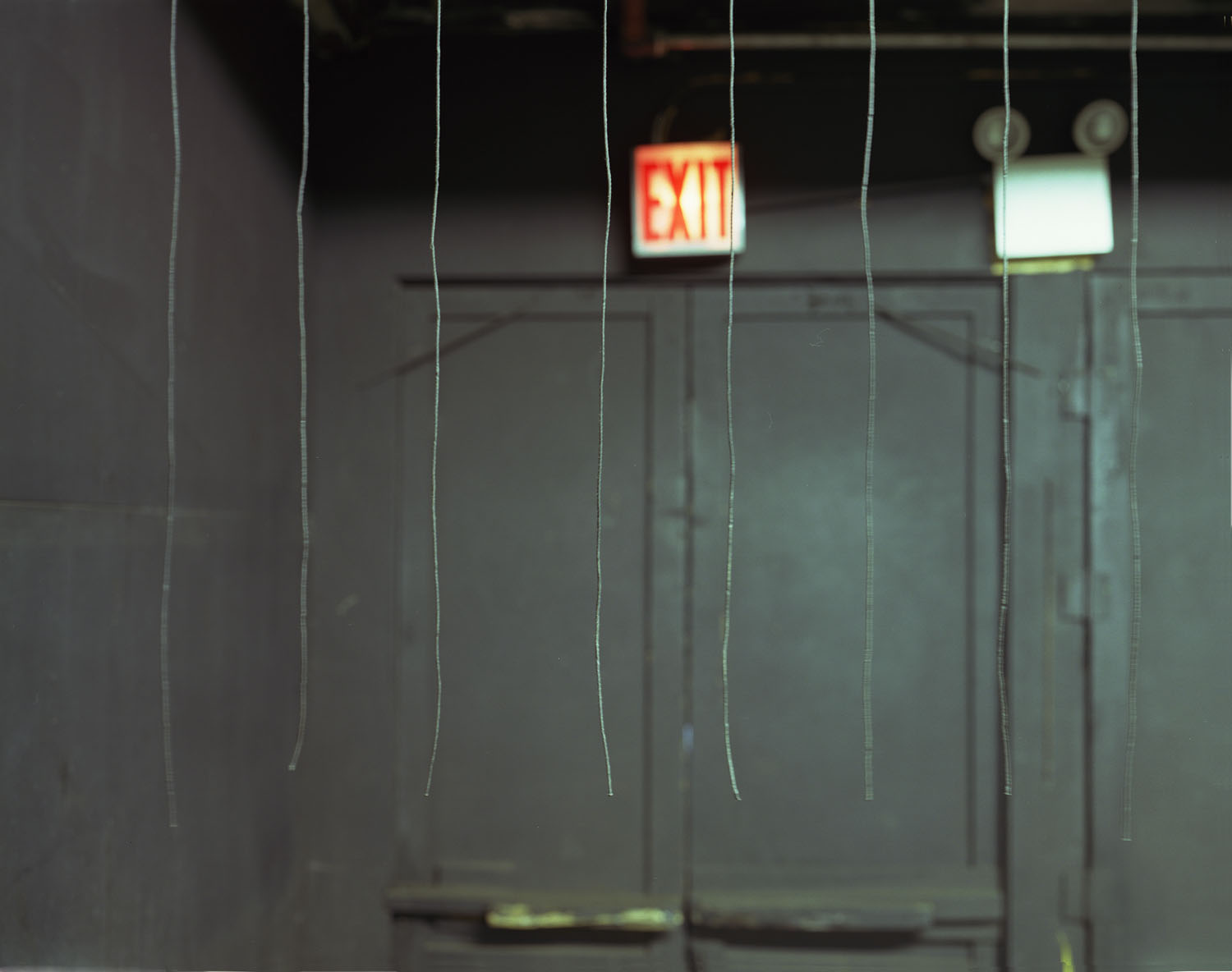 Exit sign with strings                               Spook-A-Rama, Coney Island, N.Y., 2004