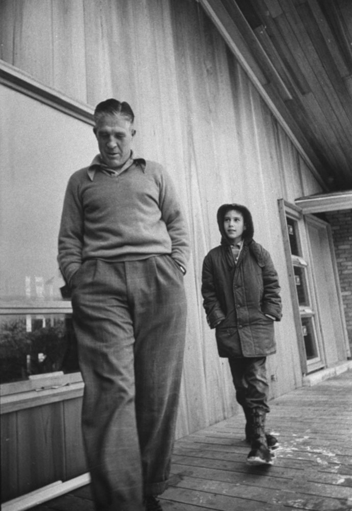 <b>Caption from LIFE.</b> With 'Mitt,' 10, youngest of Romney children, [George Romney] inspects house at Bloomfield Hills which he and his wife designed.
