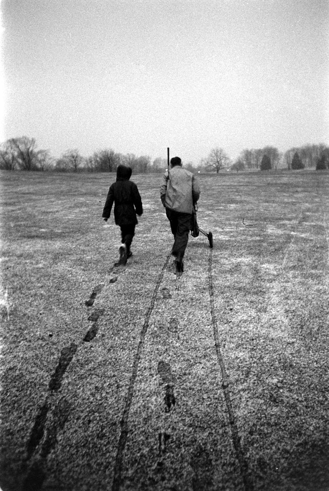George Romney with his son, Mitt, on a frosty golf course, 1958.
