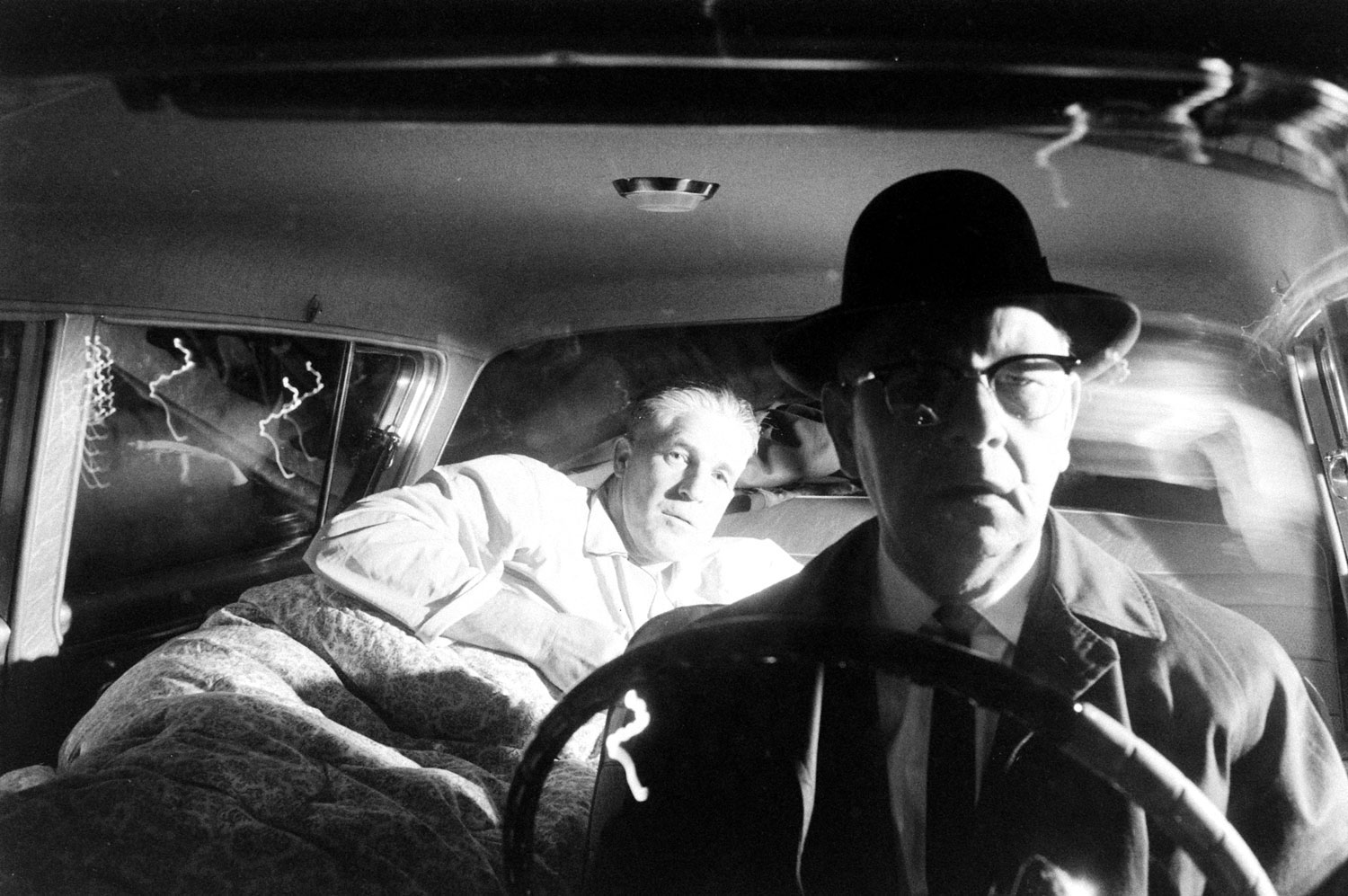 <b>Caption from LIFE.</b> At end of a long day on the new state constitution -- and after a quick change to pajamas -- Romney falls asleep on fold-back seat of his car as the chauffeur begins the trip back to Bloomfield Hills.